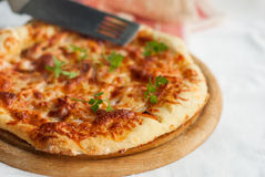 Pizza ham and mushroom on wooden board Stock Images
