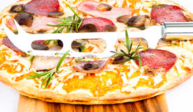 Pizza with ham, mushrooms ans salami Royalty Free Stock Photo