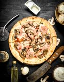 Pizza with ham, mushrooms and cheese. Stock Image