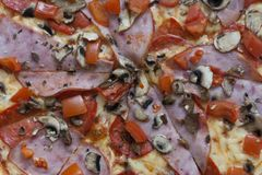 Pizza with ham and mushrooms photo royalty free stock images