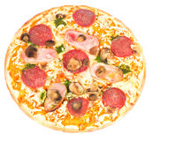 Pizza with ham, mushrooms and salami Stock Photography