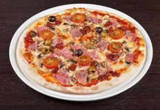 Pizza with ham and mushrooms Royalty Free Stock Image