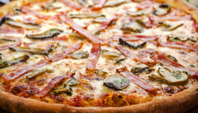 Pizza ham and mushrooms 2. Pizza with ham and mushrooms on a wooden table Stock Photography
