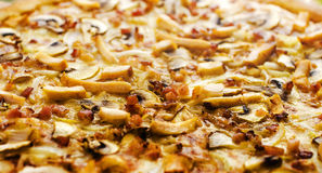 Pizza ham and mushrooms 2. Pizza with ham and mushrooms on a wooden table Royalty Free Stock Photography