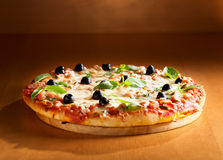 Pizza with ham and olives Stock Images