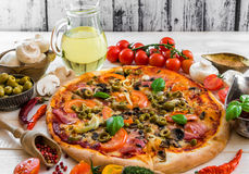 Pizza with ham and olives Royalty Free Stock Image