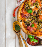 Pizza with ham and olives Stock Photo