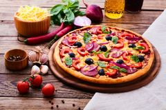 Pizza with ham, pepper and olives. Delicious fresh Stock Photo