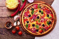 Pizza with ham, pepper and olives. Delicious fresh Stock Images