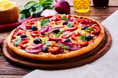 Pizza with ham, pepper and olives. Delicious fresh Stock Image