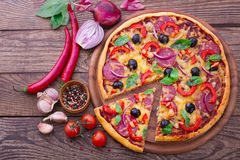 Pizza with ham, pepper and olives. Delicious fresh Royalty Free Stock Photography