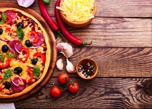 Pizza with ham, pepper and olives. Delicious fresh Royalty Free Stock Photo