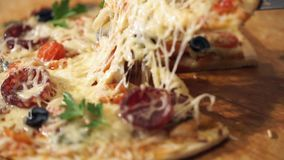 Pizza with ham, pepper, tomato and olives stock video