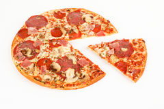 A pizza with ham and salami royalty free stock photo