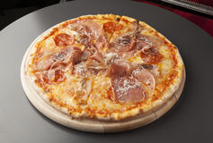 Pizza with ham and sausage Royalty Free Stock Photo