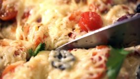 Pizza with ham, tomato and olives. Macro shot. stock video footage