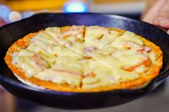 Pizza ham tops up with supreme cheese and crab stick at the  Foodtrack event in Bangkok, Thialand royalty free stock images