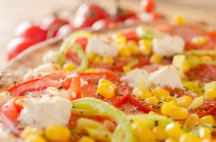 Pizza with ham and vegetables Stock Image