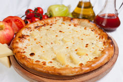 Pizza Hawaii. With pineapple and cheese stock images