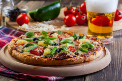 Pizza hawaii with beer Royalty Free Stock Image