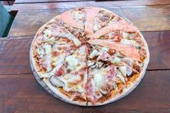 Pizza Hawaiian and Salmon pizza Stock Photo