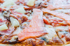 Pizza Hawaiian and Salmon pizza Stock Images