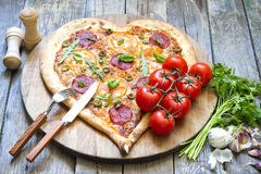 Pizza heart shape with cheese and tomato Royalty Free Stock Photography