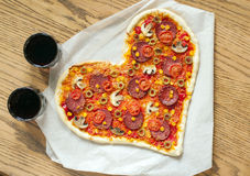 Pizza heart shaped with pepperoni, Stock Photography