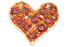 Pizza heart shaped with pepperoni, isolated on white background Royalty Free Stock Photos
