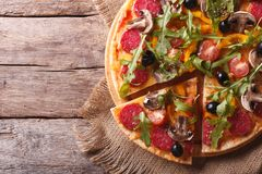 Pizza with herbs, salami and vegetables horizontal top view Stock Images