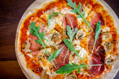 Pizza. Homemade pizza on wood board Stock Images