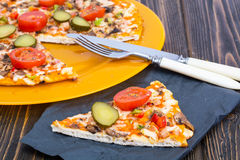 Pizza hommemade on orange plate. royalty free stock photography