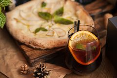 Pizza with hot cocktail royalty free stock photos