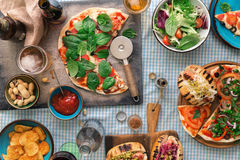 Pizza, hot dog, salad, wine, beer and snacks for beer Royalty Free Stock Photo