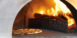 Pizza in hot firewood Oven for cook stock images