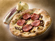 Pizza with hot salami and scamorza Royalty Free Stock Images