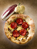 Pizza with hot salami and scamorza Stock Photos