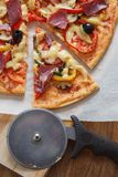 Pizza with hum, cheese, tomato and pepper Royalty Free Stock Image
