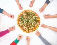 Pizza and human hands Royalty Free Stock Photography
