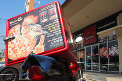 Pizza Hut heat storage box on delivery motorcycle and shop Royalty Free Stock Photos