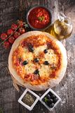 Pizza and ingredient. On wood Royalty Free Stock Photo
