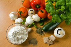 Pizza ingredients. Fresh and colorful ingredients for baking a pizza stock photo