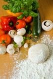 Pizza ingredients. Fresh and colorful ingredients for baking a pizza royalty free stock image