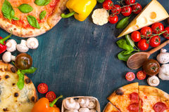Pizza and ingredients background royalty free stock photography