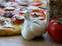 Pizza ingredients garlic bulb, tomato, spices Royalty Free Stock Photography