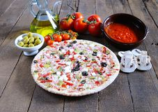 Pizza and ingredients. Royalty Free Stock Photos