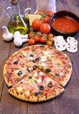 Pizza and ingredients. Stock Images