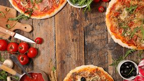 Pizza and ingredients Royalty Free Stock Images