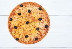 Delicious pizza and ingredients on white background Stock Photo