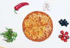 Delicious pizza and ingredients on white background Stock Images